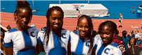Relay Team Takes First at Penn Relays photo